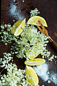 Elderflowers, lemon wedges and sugar (seen from above)