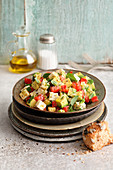 Gluten-free avocado salad with tomatoes and feta