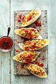 Bulgur salad with pomegranate seeds in chicory boats