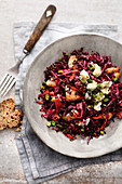 Red cabbage salad with black rice, gorgonzola and chicken breast