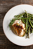 Chicken with gravy, thyme and green asparagus (top view)