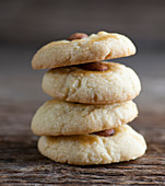 Four almond cookies, stacked (close up)