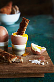 A soft-boiled egg and soldiers