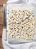 Broken white chocolate with dried fruit and pistachio nuts