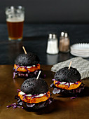 Mini black burgers with salmon patties