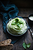 Cucumber spaghetti with a vegan basil and sesame seed dressing