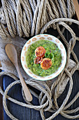 Bavaria meets Spain – pea soup with scallops and serrano ham