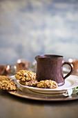 Christmas biscuits and mug on plate