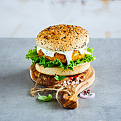 Healthy homemade vegan carrot and oats burger, wholegrain buns