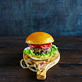 Detox veggie burger with quinoa patty, lettuce and tomatoes