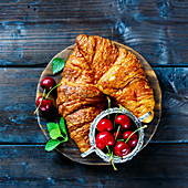Breakfast croissants and fresh cherry
