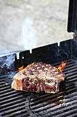 Porterhouse steak on a grill