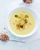 Brussels sprouts and parsnip soup with diced ham and oats