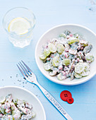 Cucumber salad with ham and grapes