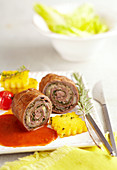 Italian beef roulade with polenta and tomato sauce