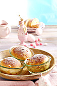 Mini Easter panettone in jars in a wooden bowl