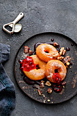 Apple doughnuts in beer batter with pomegranate sauce