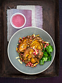 Chicken with walnuts and pomegranate (khoresht fesenjan, Persia)