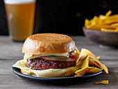 The Bobby Flay Ground Chuck Burger with Ham and Cheese and a side of Banana Chips