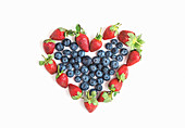 Heart sign made of fresh blueberries and strawberries