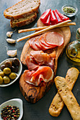 Wooden board with italian antipasti