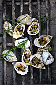 Grilled oysters with bacon and gherkins