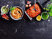 Vier Grillsaucen (Zitronenbutter, Romesco, Barbecuesauce, Chimichurri)