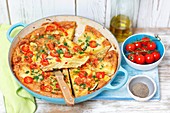 Potato tortilla with courgette and cherry tomatoes