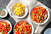 Tomato, sour cucumbers, corn and pepper salad
