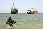 Diver at boat scrapyard, Mauritania