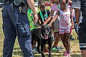 Children petting US Customs dog