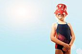Girl with sunhat covering face