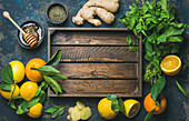 Ingredients for making natural hot drink: oranges, mint, lemons, ginger, honeycomb and apple