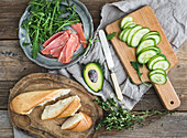 Salmon and avocado sandwiches with fresh thyme in baguette