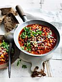 Chickpea, chorizo and pinenut stew