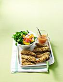 Panierte Hähnchenbrustfilets aus dem Ofen mit Zitrus-Salat