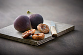 Fresh and dried figs on a wooden board