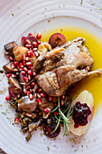 Portuguese Mediterranean dish of roast chicken in olive oil served with rosemary and pomegranate (Portugal)