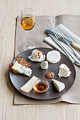 A cheese platter with various types of goat's and cow's milk