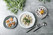 Blinis with salmon, steamed oriental dumplings, and a meringue tartlet