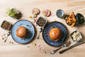 Mealworm burgers – buns with a veggie patty and worms served with sweet potato chips
