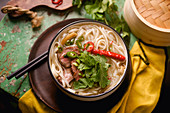 Vietnamese traditional soup Pho Bo with beef and fresh coriander