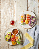 Spring rolls with vegetables and citrus fruits