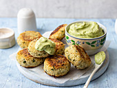 Cous cous and cauliflower patties, avocado and yogurt dip