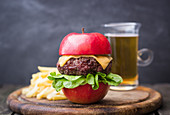 Burger with cheese and salad in apple, frensh fries, beer