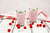 Raspberry lassi with mint leaves