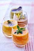 Four ratatouille soups in glasses
