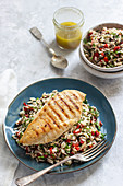 Rice salad with roasted pepper, chilli, dill, parley and lemon dressing and grilled chicken breast