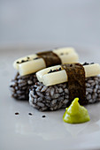 Vegan nirgiri sushi with black rice and sweet and sour pickled lotus roots
