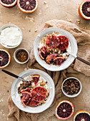 Yogurt bowls with blood orange, topped with granola
